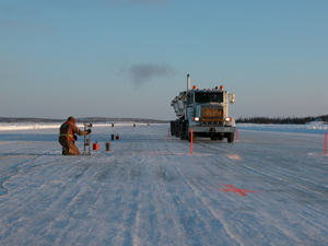 Measuring ice deflection on the Tibbitt to Contwoyto winter road in the Northwest Territories (photo credit: Don Hayley)